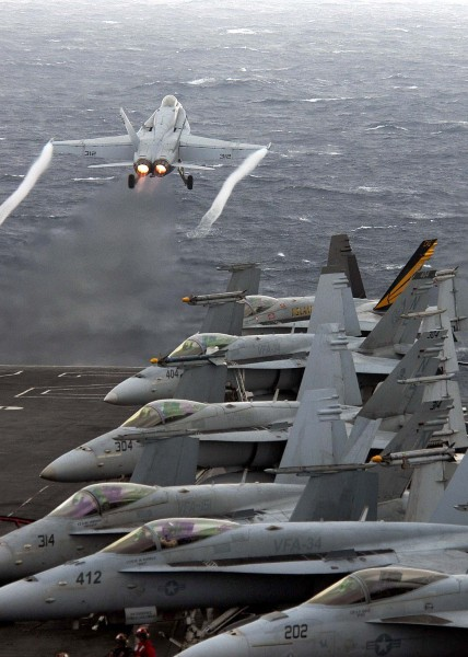 US Navy 060322-N-9079D-037 An F-A-18C Hornet assigned to Strike Fighter Squadron One Five One (VFA-151), launches off the flight deck aboard the Nimitz-class aircraft carrier USS Abraham Lincoln (CVN 72)