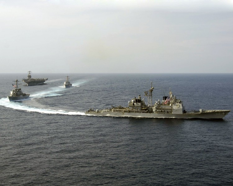 US Navy 060416-N-5837R-113 USS Mobile Bay (CG 53), USS Russell (DDG 59), and USS Shoup (DDG 86) perform a pass and review with the Nimitz-class aircraft carrier USS Abraham Lincoln (CVN 72)
