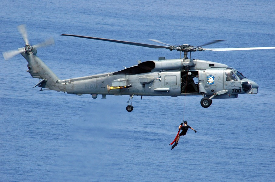 US Navy 060417-N-9079D-095 An SH-60B Seahawk helicopter assigned to Helicopter Anti-Submarine Squadron Light Four Seven (HSL-47) deploys a search and rescue swimmer