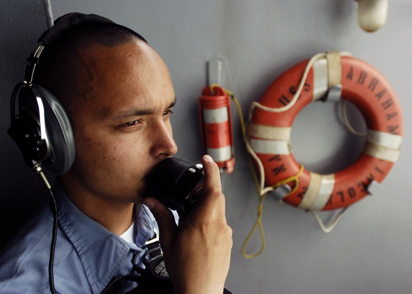 US Navy 060424-N-0499M-005 Seaman Tony A. Brundage stands the starboard aft lookout during a sea and anchor detail