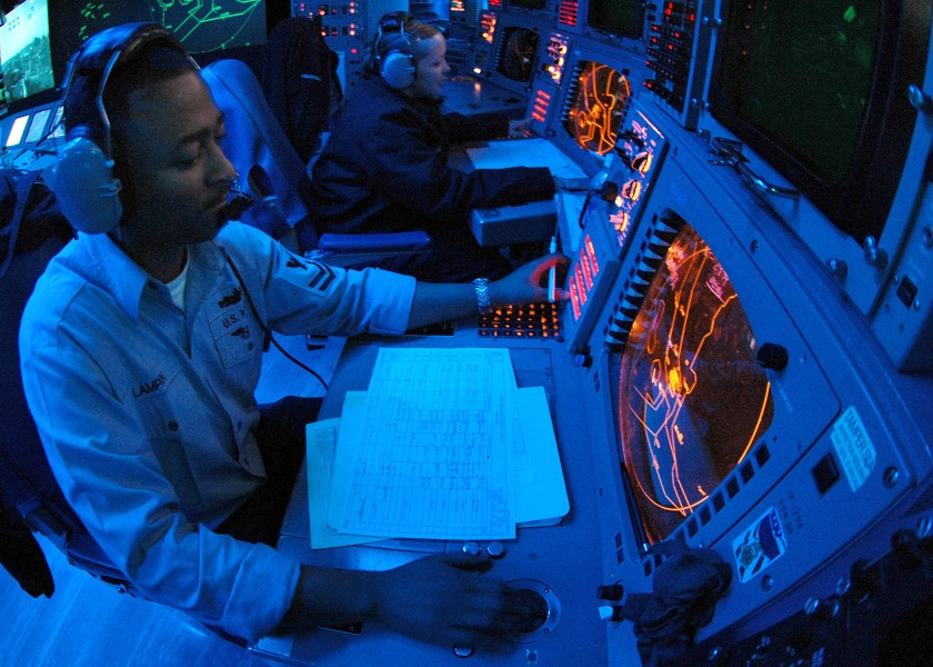 US Navy 060502-N-9079D-002 Operations Specialist 2nd Class Anthony S. Lampkin tracks contacts in Combat Direction Center (CDC) aboard USS Abraham Lincoln (CVN 72)