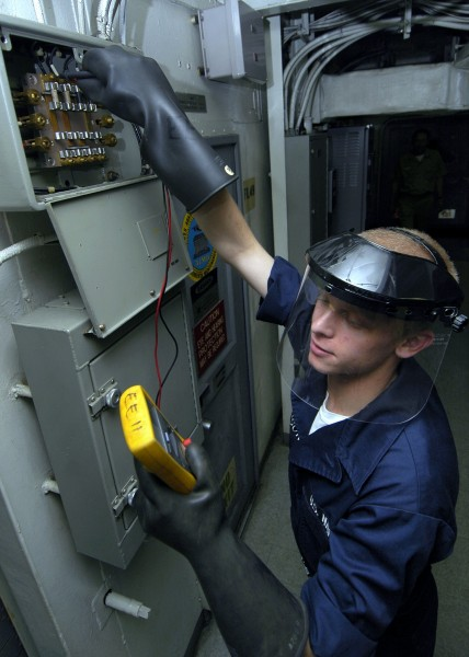 US Navy 060504-N-1745W-156 Electricians Mate Fireman Drew changes a fuse in a distribution box aboard the Nimitz-class aircraft carrier USS Abraham Lincoln (CVN 72)