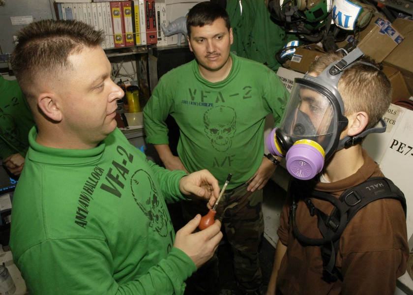 US Navy 060505-N-6060O-061 Strike Fighter Squadron Two (VFA-2) crew members earn hazardous material qualifications aboard the Nimitz-class aircraft carrier USS Abraham Lincoln (CVN 72)