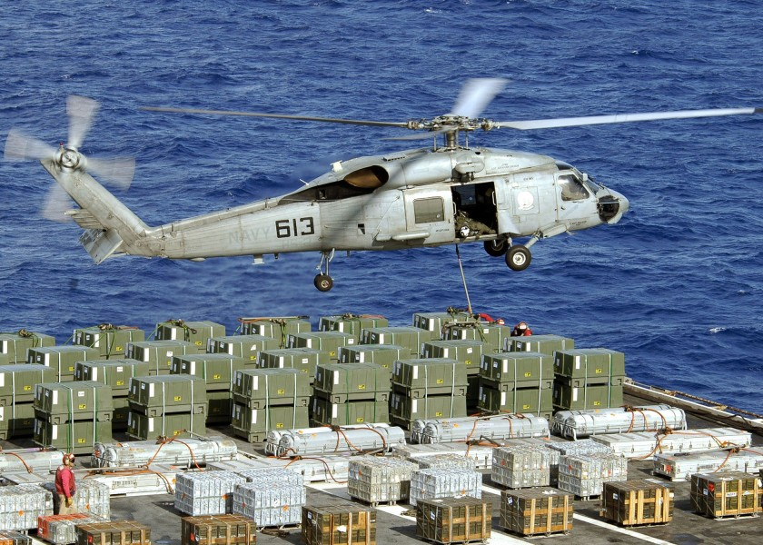 US Navy 060624-N-9898L-080 An SH-60 Seahawk assigned to the Golden Falcons of Helicopter Anti Submarine Squadron Two (HS-2) conducts a weapons offload from USS Abraham Lincoln (CVN 72)
