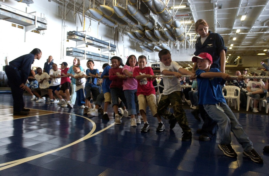 US Navy 060703-N-7130B-260 In the hangar bay aboard the Nimitz-class aircraft carrier USS Ronald Reagan (CVN 76), children of crew members play tug-o-war during a Tiger Cruise