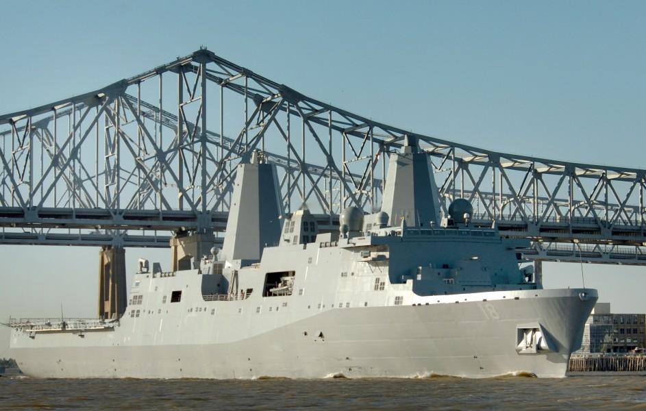 US Navy 061023-N-9995B-001 The Pre-Commissioning Unit New Orleans (LPD 18) transits past the city of New Orleans on the Mississippi River