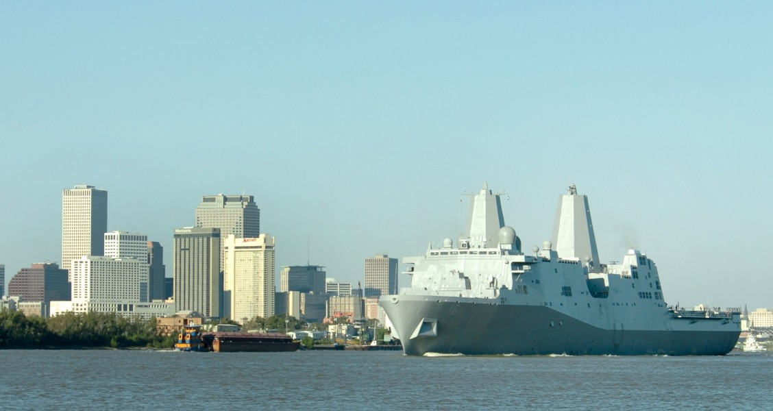 US Navy 061023-N-9995B-002 The Pre-Commissioning Unit New Orleans (LPD 18) transits past the city of New Orleans on the Mississippi River