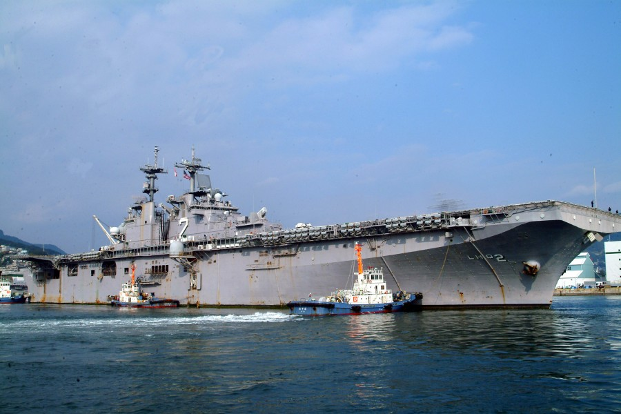 US Navy 061201-N-4124C-001 USS Essex (LHD 2) is pushed by tugs into her berth