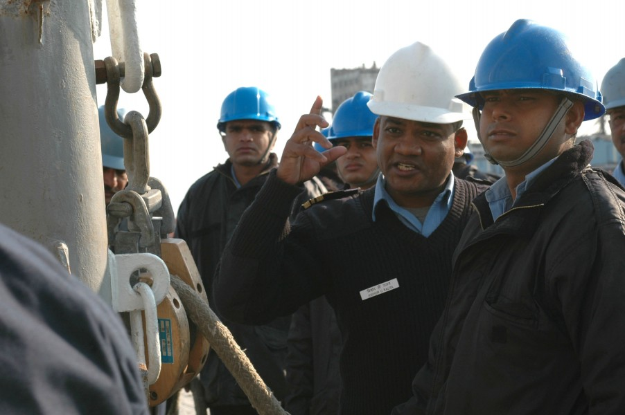 US Navy 061219-N-6410Z-474 An officer from the Indian navy instructs his junior sailors on how to properly rig a kingpost during a training exercise