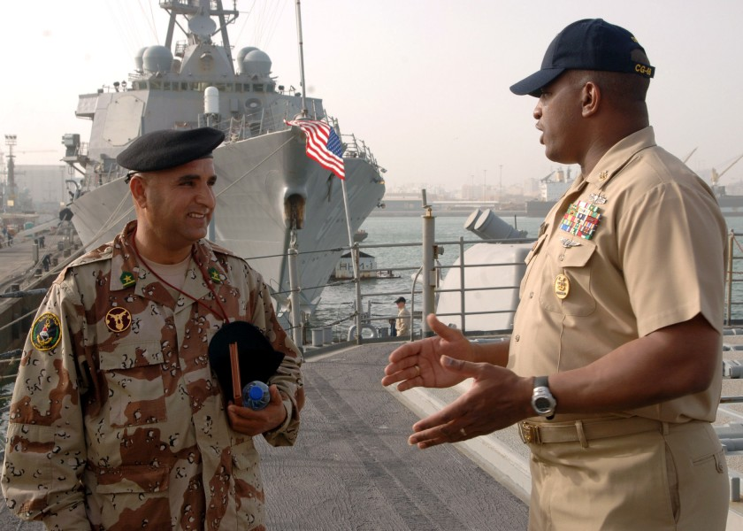 US Navy 070226-N-8560S-005 USS Anzio (CG 68) Command Master Chief William Seegars talks to Iraqi navy Chief Warrant Officer 2nd Class Abdul Majeed during a tour of the ship