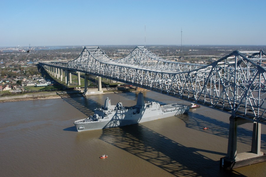US Navy 070305-N-3429E-003 Pre-Commissioning Unit New Orleans (LPD 18) transits under the Crescent City Connection Bridge, up the Mississippi River, toward her namesake city