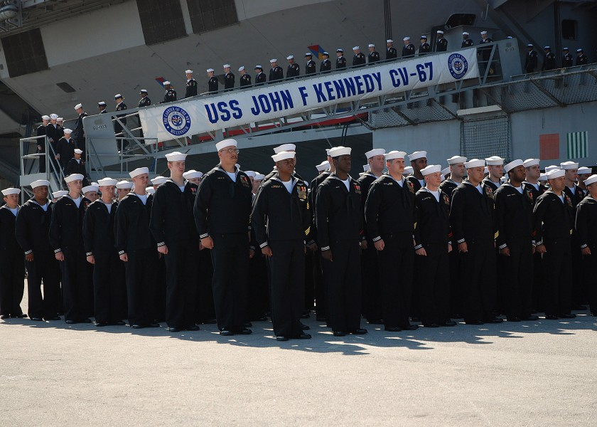 US Navy 070323-N-4565G-011 The Sailors of USS John F Kennedy (CV 67) disembark the ship near the end of the ship^rsquo,s decommissioning ceremony