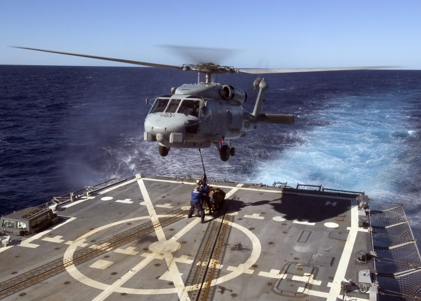 US Navy 070430-N-5253W-005 Sailors aboard the Arleigh burke-class guided-missile destroyer USS Lassen (DDG 82) connect a pallet to an SH-60B helicopter