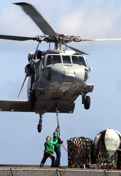 US Navy 070515-N-3038W-210 Sailors from USNS Bridge (T-AOE 10) attach supplies to an MH-60S Seahawk from the