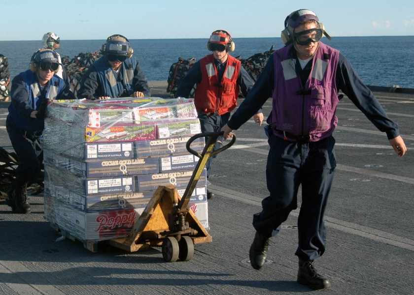 US Navy 070628-N-6710M-006 Members assigned to the flight deck crew transit supplies during a vertical replenishment (VERTREP) from the flight deck of the Dock landing ship USS Tortuga (LSD 46)