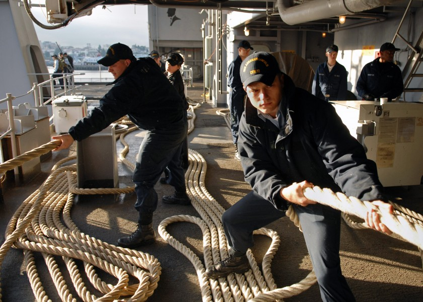 US Navy 070707-N-7981E-028 Seaman Jacob Albon and members of deck department single up lines as Nimitz-class aircraft carrier USS Abraham Lincoln (CVN 72) gets underway from her home port