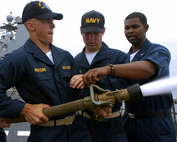 US Navy 070718-N-4163T-068 Damage Controlman 3rd Class Jason Chatman instructs midshipmen on the proper way to relieve the nozzelman on a firefighting hose