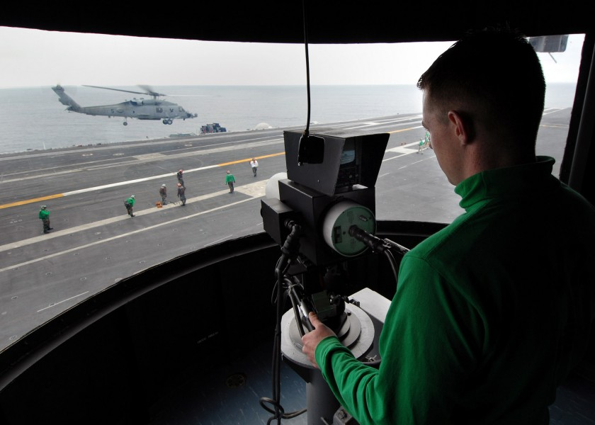 US Navy 070725-N-7981E-062 Electrician's Mate Fireman Preston Rucker, assigned to air department, operates the ship's Integrated Launch And Recovery Television Surveillance system during helicopter operations