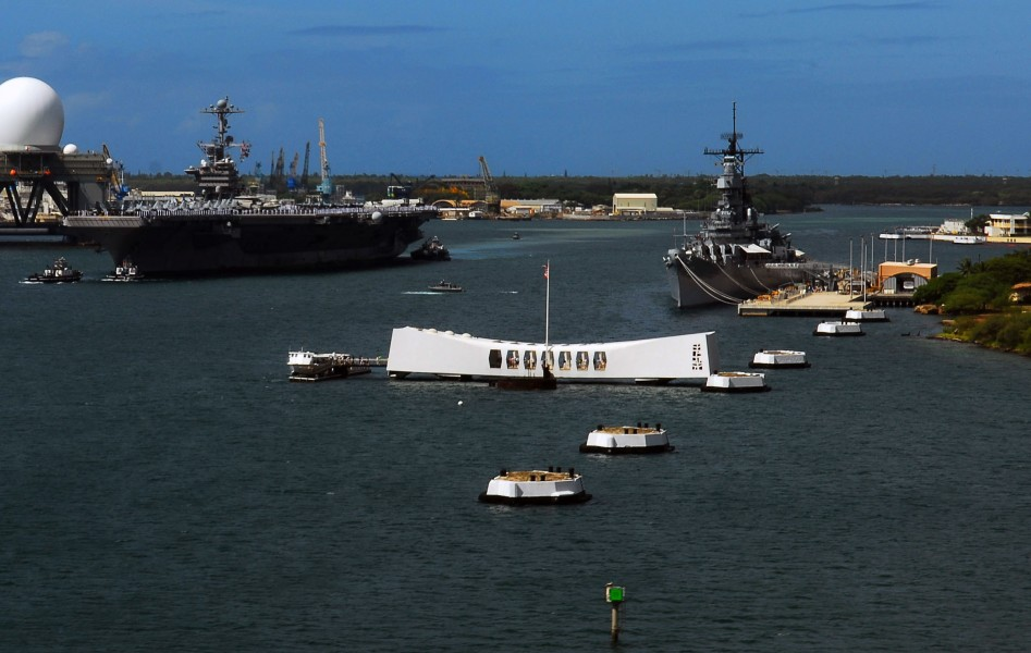 US Navy 070820-N-0684R-384 Sailors and Marines stand at attention while manning the rails as Nimitz-class aircraft carrier USS John C. Stennis (CVN 74) passes the USS Arizona Memorial