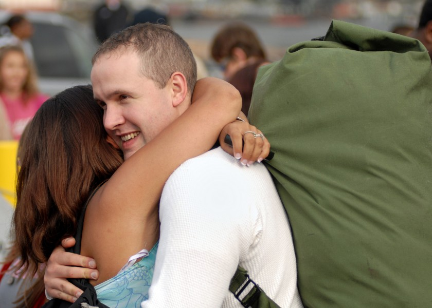 US Navy 070820-N-7981E-212 Fireman Anthony Jaques hugs his wife after his arrival home aboard the Nimitz-class aircraft carrier USS Abraham Lincoln (CVN 72)