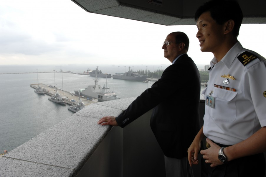 US Navy 070821-N-3642E-163 Singapore's Chief of the Navy Rear Adm. Ronnie Tay briefs Secretary of the Navy (SECNAV) the Honorable Dr. Donald C. Winter on port facilities at Changi Naval Base