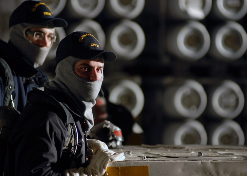 US Navy 071016-N-7981E-092 Members of air department stand fire watch in the hangar bay of Nimitz-class aircraft carrier USS Abraham Lincoln (CVN 72) during an ordnance onload at Naval Magazine Indian Island