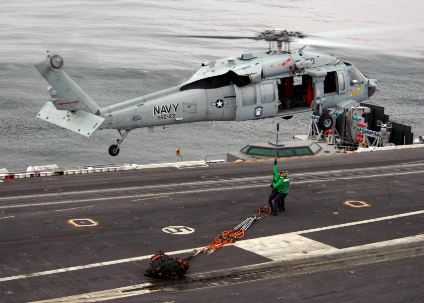 US Navy 071103-N-9898L-203 Sailors attach a hoisting cable to an MH-60S Seahawk, assigned to the