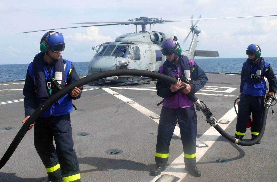 US Navy 080626-N-7109S-189 Flight deck crew members assigned to the Republic of Singapore Navy frigate RSS Tenacious perform a hot pump refueling