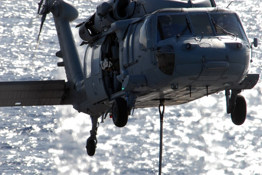 US Navy 080710-N-1635S-006 An aircrewman aboard an MH-60S Seahawk assigned to the