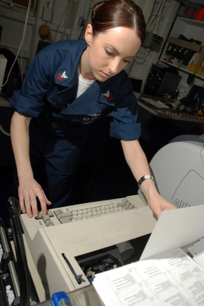 US Navy 080711-N-9450M-018 Yeoman 1st Class Julie Eubanks, of Rockwall, Texas, types an enclosure letter in the administrative office aboard the Nimitz-class aircraft carrier USS Abraham Lincoln (CVN 72)