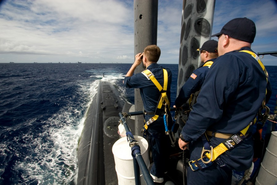 US Navy 080729-N-8061H-086 ailors aboard the fast-attack submarine USS Los Angeles (SSN 688) watch from the bridge as ships from multiple nations gather in a 26-ship formation