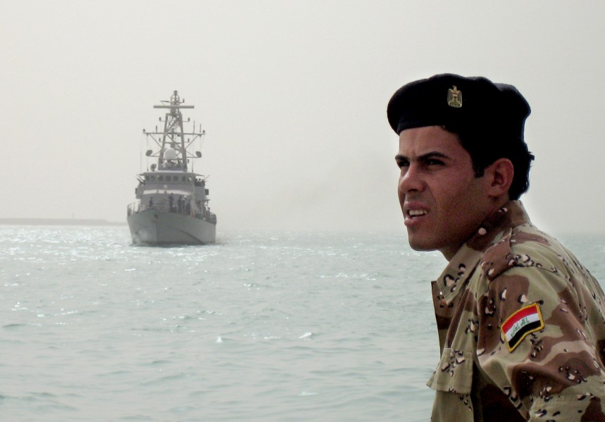 US Navy 080813-N-5068C-008 An Iraqi sailor looks on from the pier as the coastal patrol boat USS Firebolt (PC 10) arrives at the port of Umm Qasr