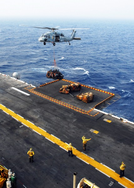 US Navy 080831-N-2183K-043 An MH-60S Sea Hawk helicopter delivers crates of supplies to the amphibious assault ship USS Peleliu (LHA 5) during a vertical replenishment at sea
