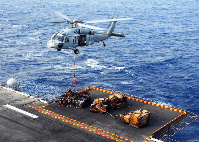 US Navy 080831-N-2183K-044 An MH-60S Sea Hawk helicopter delivers crates of supplies to the amphibious assault ship USS Peleliu (LHA 5) during a vertical replenishment at sea