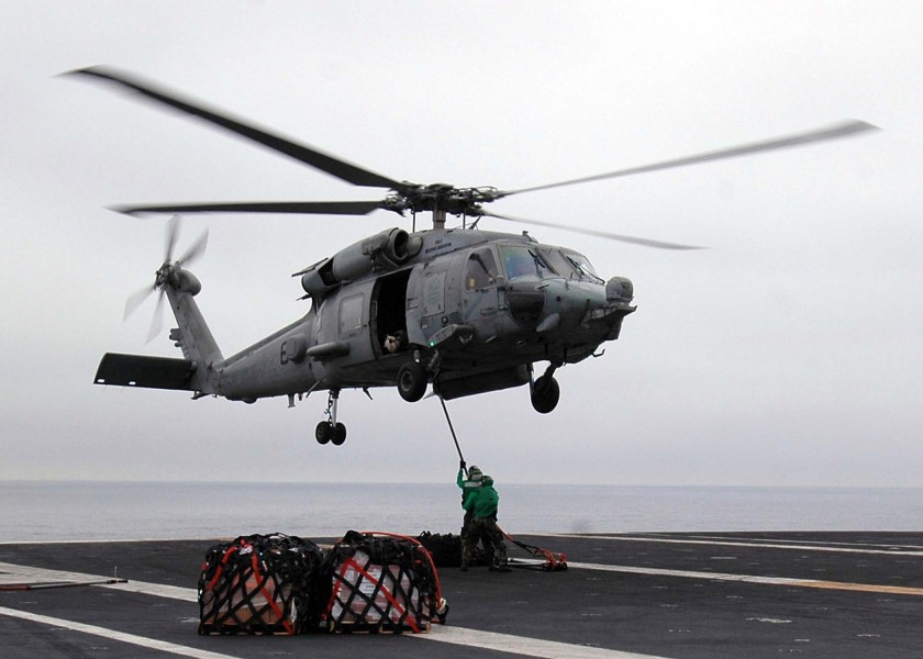 US Navy 080903-N-1161Z-092 Sailors aboard USS George Washington (CVN 73) attach a cargo pendant to an HH-60H Sea Hawk helicopter during a vertical replenishment at sea with USNS Henry J. Kaiser (T-AO 187)