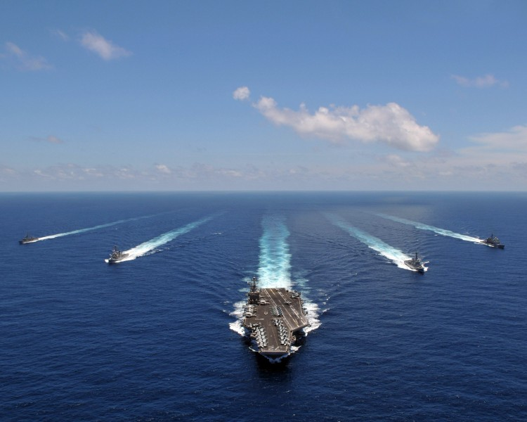 US Navy 080905-N-7981E-845 The aircraft carrier USS Abraham Lincoln (CVN 72) leads a formation of ships from the Abraham Lincoln Strike Group they transit the Indian Ocean