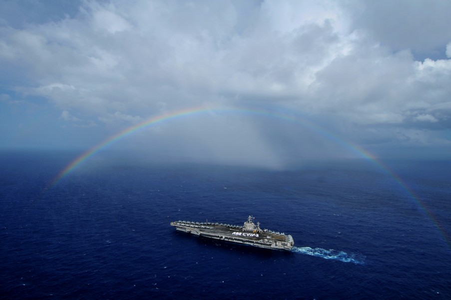 US Navy 080927-N-7981E-418 The aircraft carrier USS Abraham Lincoln (CVN 72) passes under a rainbow as Sailors from Lincoln and Carrier Air Wing (CVW) 2 participate in a