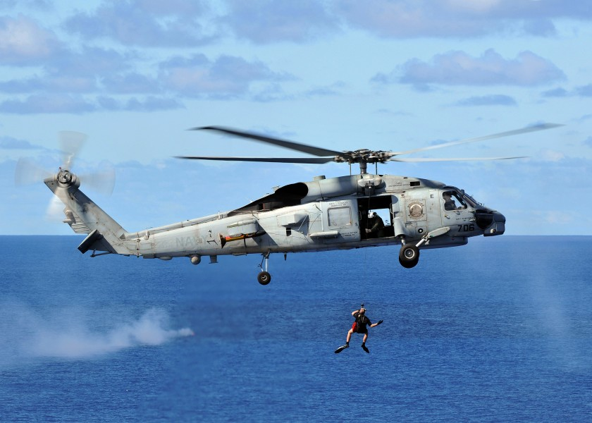 US Navy 080929-N-7981E-498 A rescue swimmer is hoisted back into an SH-60B Sea Hawk helicopter assigned to the