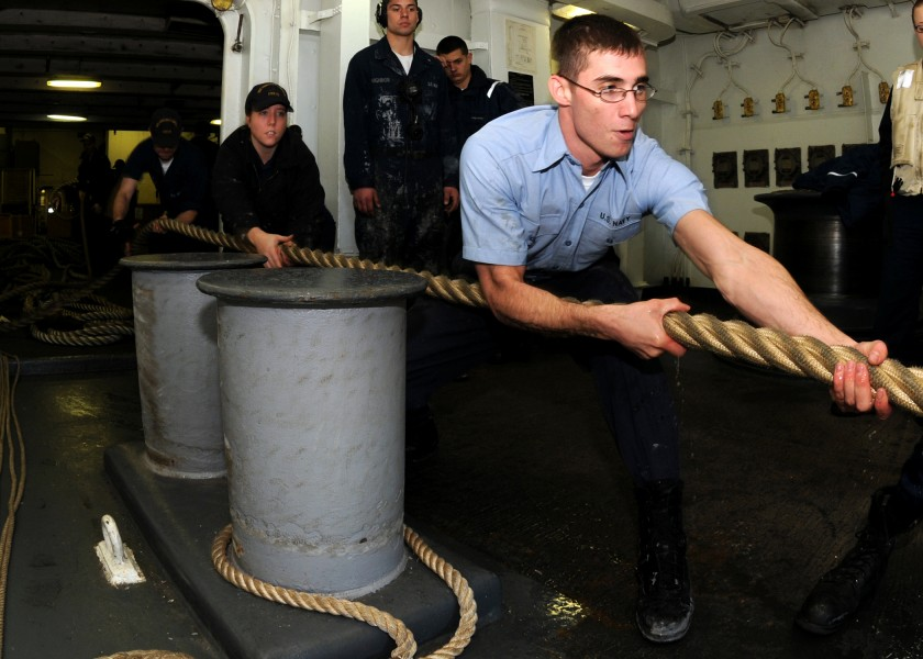 US Navy 081201-N-9898L-036 Seaman Chase Butler heaves a mooring line