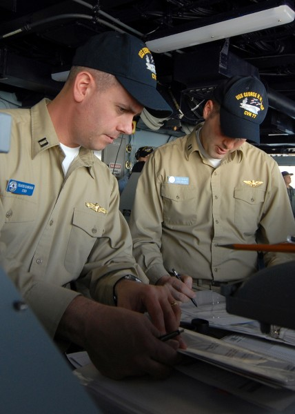 US Navy 090213-N-5658B-016 Lt. Travis Dawson and Lt. James Thomas stand bridge watch