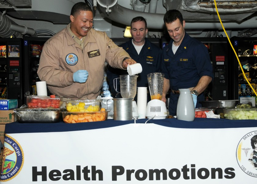 US Navy 090317-N-4856N-056 Officers aboard SS Abraham Lincoln (CVN 72) prepare fresh-fruit smoothies for Sailors