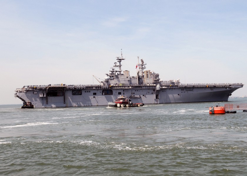 US Navy 090513-N-9985W-059 Tugs assists the multi-purpose amphibious assault ship USS Bataan (LHD 5) departs Naval Station Norfolk on a regularly scheduled deployment