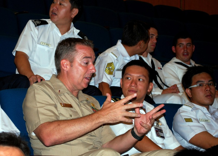 US Navy 090619-N-0869H-017 Chief Warrant Officer Troy Roat, assigned to Mobile Diving and Salvage Unit (MDSU) 1, Company 14, speaks with a Republic of Singapore Navy officer