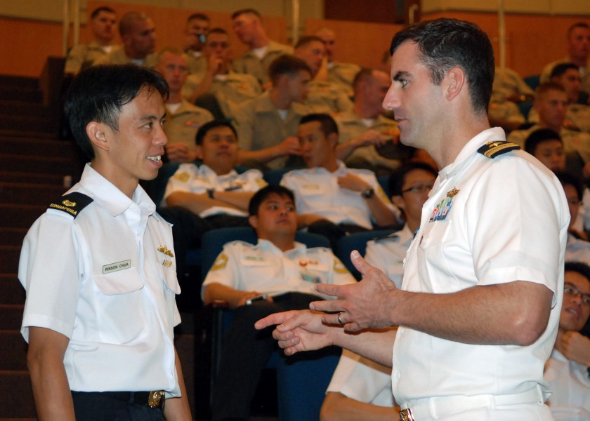 US Navy 090619-N-5207L-040 Republic of Singapore Navy Maj. Rinson Chua speaks with Lt. Cmdr. Greg Adams of Commander