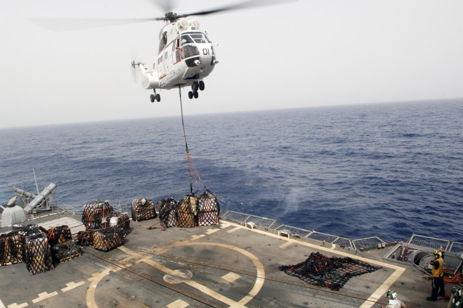 US Navy 090716-N-9301D-150 A SA-330 Puma helicopter assigned to the combat stores ship USNS San Jose (T-AFS 7) drops a load of stores onto the flight deck of USS Anzio (CG 68) during a vertical replenishment