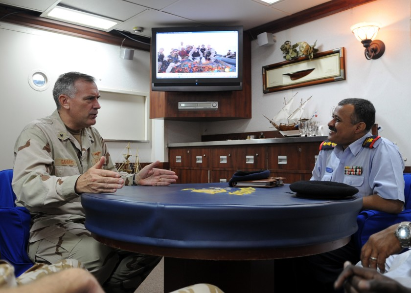 US Navy 090912-N-6814F-089 Rear Adm. Scott E. Sanders speaks with Col. Lofta Al Barati during a visit aboard the guided-missile cruiser USS Anzio (CG 68)