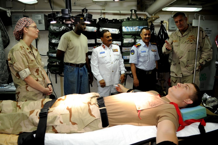 US Navy 090912-N-6814F-202 Rear Adm. Scott E. Sanders explains a medical training exercise to Col. Lofta Al Barati and Brig. Gen. Shamshan Radhan during a visit aboard the guided-missile cruiser USS Anzio (CG 68)