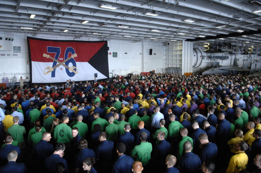 US Navy 090913-N-9818V-150 Sailors gather in the hangar bay of the aircraft carrier USS Ronald Reagan (CVN 76) for an all-hands call with Master Chief Petty Officer of the Navy (MCPON) Rick West