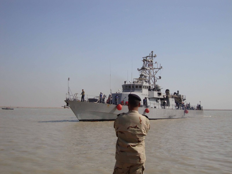 US Navy 091114-N-0000X-001 A member of the Iraqi Defense Forces watches as the coastal patrol boat USS Firebolt (PC 10) approaches Umm Qasr, Iraq