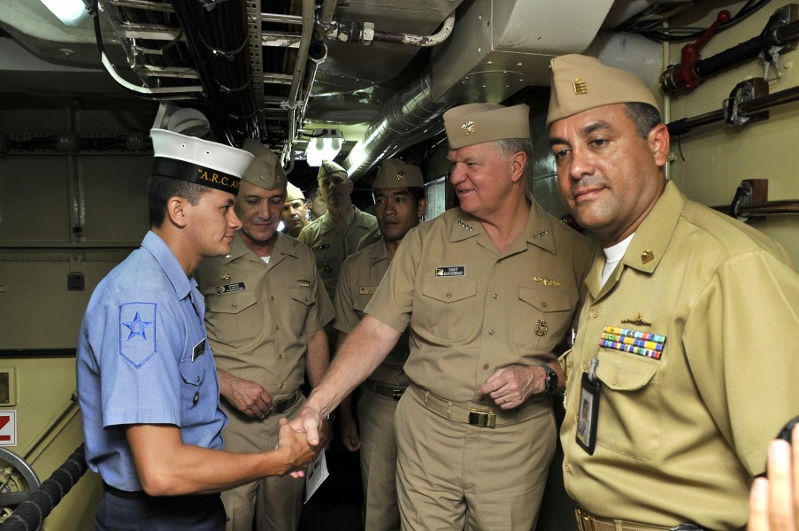 US Navy 091205-N-8273J-066 Chief of Naval Operations (CNO) Adm. Gary Roughead, middle, speaks with Columbian sailors while touring the Colombian navy frigate ARC Antioquia (FL 53)